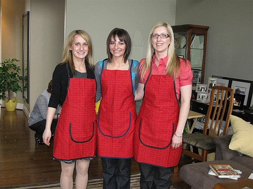 Here is the picture of the girls wearing the Mmmm aprons I made for their wedding showers.