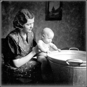woman & baby by tub