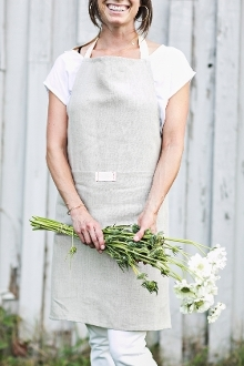 full bistro apron with pocket. heirloomed is a 100% linen collection packaged in a kraft bag nostalgic of a rustic market bakery and tied with a single waxed thread cord. set upon a classic neutral palette, each heirloomed piece includes a signature tag detail with simple red stitching.