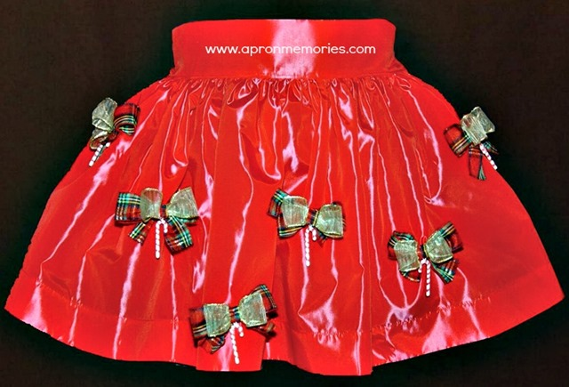 xmas apron on black by Raelene