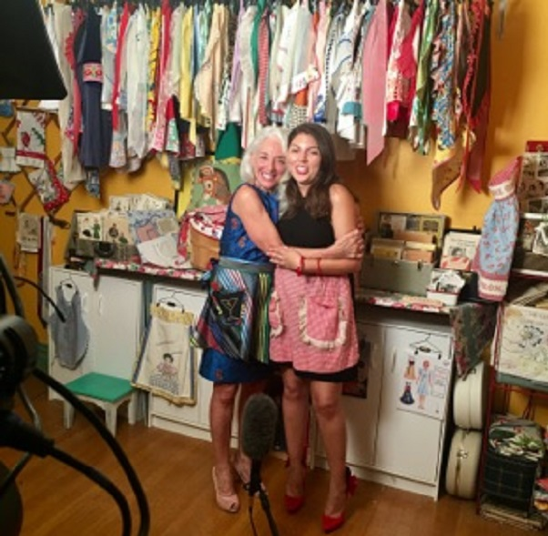 A happy hug after chatting for an hour about our apron journeys in cute aprons and fabulous heels